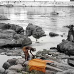 An old man taking bath on the riverbed in Betwa river in Orcha