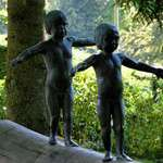 """Continuity"" - bronze statues of boy & girl"
