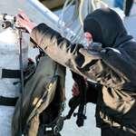 Diver preparing equipment