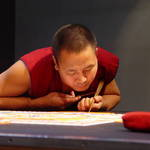 Monk working on mandala