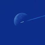 Plane flying through the moon