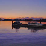 Sunset dock & two boats moored